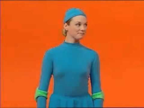 One of the casts of 4 Square, a Canadian television show for kids, wearing all blue outfits with an orange background.