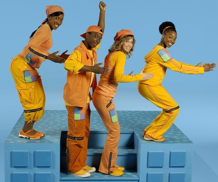 Casts of 4 Square, a Canadian television show for kids, wearing a combination of color yellow and orange outfits.