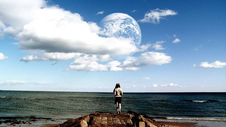 another earth rhoda essay Another earth release: 2011 length: 92 minutes a planet similar and close to earth is discovered and called earth 2 rhoda drives her car looking at earth 2 and crashes with composer john burroughs however, and submits an essay to a contest where the prize is a ticket to travel to.