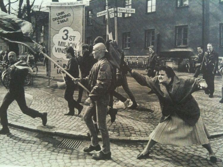 A Woman Hitting a Neo-Nazi With Her Handbag A woman hitting a NeoNazi with her handbag in Sweden 1985