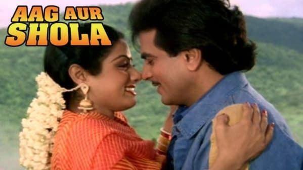 Poster of Aag Aur Shola, a 1988 Indian Bollywood film featuring Jeetendra as Vishal and Mandakini as Usha.
