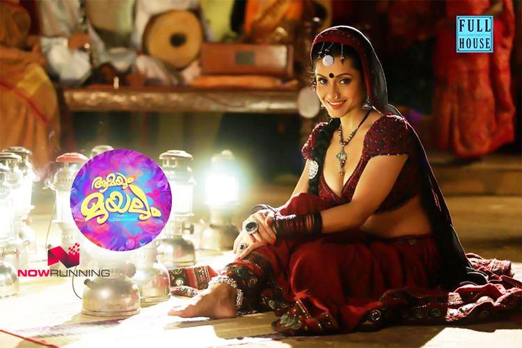 Aamayum Muyalum movie scenes  cinema Amayum Muyalum Actress Bhavana Pani is looking gorgeous in this bhanjara look pavada blouse