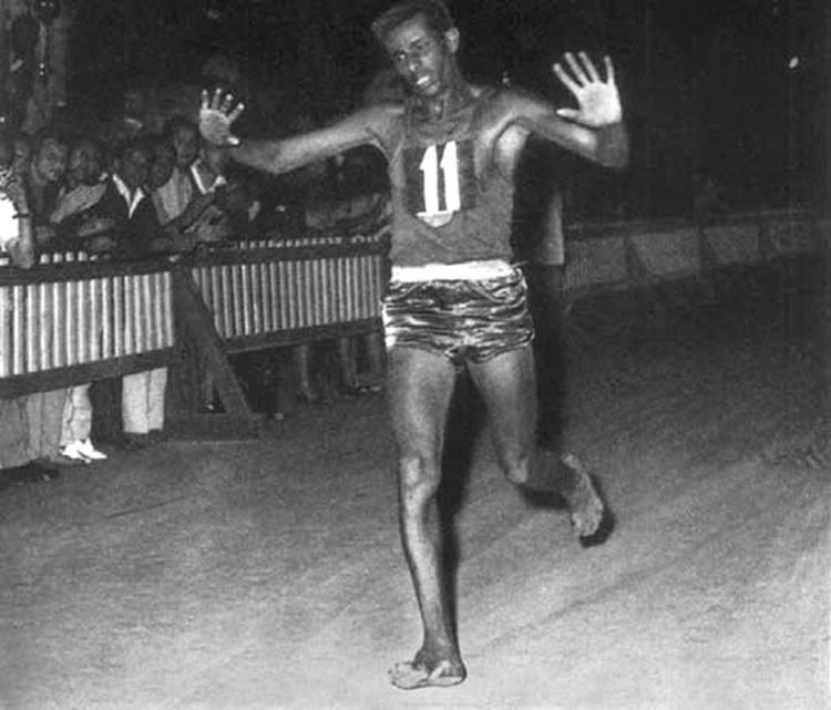 Abebe Bikila Abebe Bikila of Ethiopia running barefoot about to win