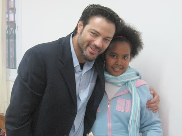 Aki Avni Actor Aki Avni charms needy Israeli children with his famous smile