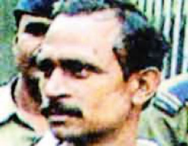 Akku Yadav with a mustache, an Indian gangster, robber, home invader, kidnapper, serial rapist, extortionist, and serial killer.
