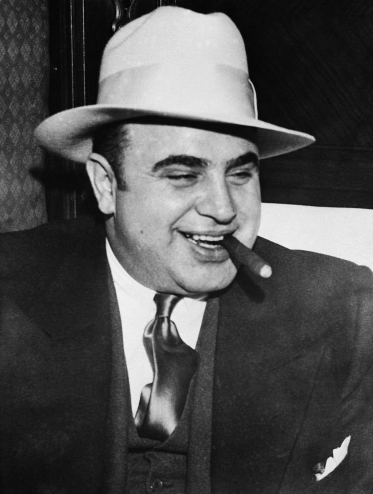 Al Capone gangsteralcaponesmokingcigar Al Capone and