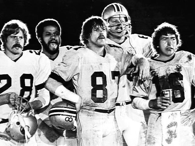 Americas Team movie scenes There are many sports fans who will remember Nick Nolte as Pete Bell head coach of the Western Dolphins team that featured Butch McRae Neon Boudreaux and