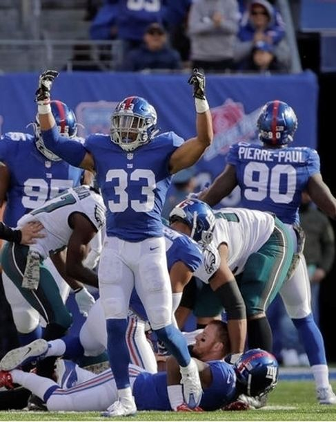 Andrew Adams (American football) NFL Photo Store Andrew Adams reacts after a defensive play against