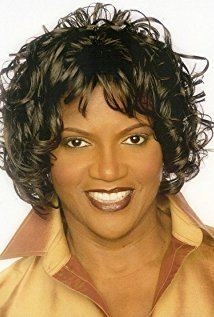 Anna Maria Horsford smiling while wearing a brown blouse