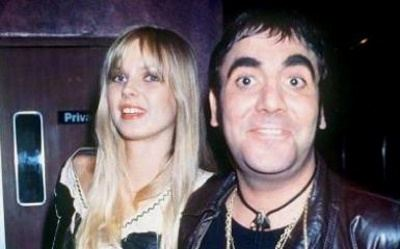 Annette Walter-Lax wearing black and white dress and Keith Moon wearing black leather jacket, black t-shirt and necklace
