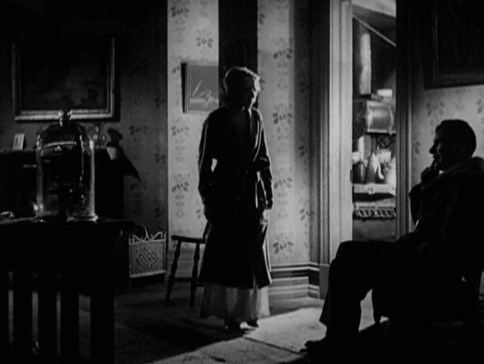 Arrowsmith (film) movie scenes This scene is wonderful visual geometry as we see Arrowsmith on the right longing for his research career the microscope on the left with his wife coming