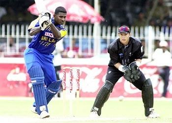 Avishka Gunawardene cracks one through the covers Photo Global