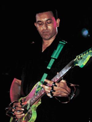 Aziz Ibrahim Louder Than War talk to Aziz Ibrahim guitarist with
