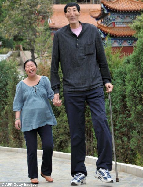 Bao Xishun First pictures of the world39s tallest dad cradling his