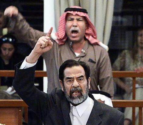 Barzan Ibrahim al-Tikriti Saddam39s halfbrother dragged from court World smhcomau
