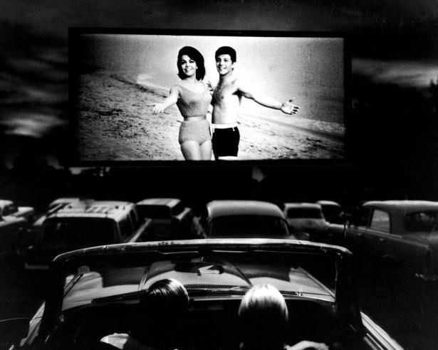 Beach Blanket Bingo movie scenes Annette Funicello and Frankie Avalon in a scene from Beach Blanket Bingo shown at a drive in movie theater in Florida 1965