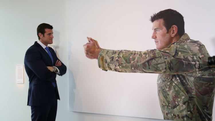 Ben Roberts-Smith VC winner Ben Roberts Smith with large portrait at the Australian