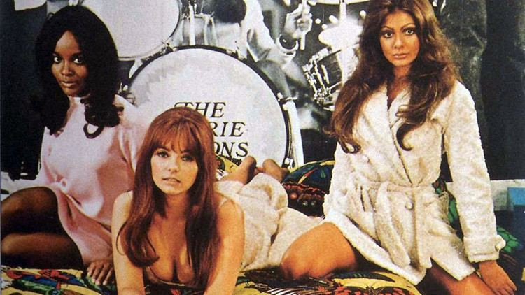 Beyond the Valley of the Dolls movie scenes The Carrie Nations from L R Pet Kelly and Casey can play a great rock song but ultimately they re all big hair big eyes and big breasts and big on