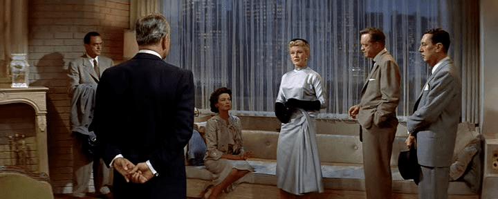 Black Widow (1954 film) movie scenes from left to right Harry Carter George Raft Gene Tierney Ginger Rogers Van Heflin Reginald Gardiner