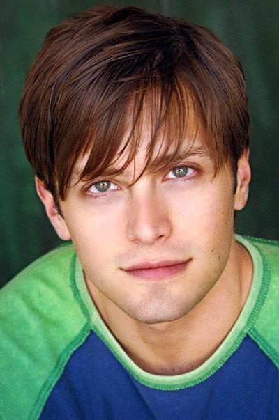 Brett Chukerman wearing a green and blue t-shirt