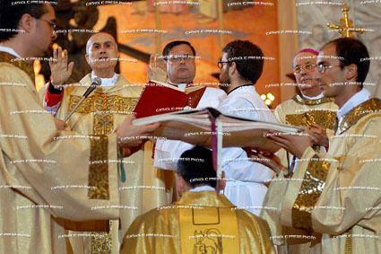Carlo Chenis Cardinal Tarcisio Bertone attends a mass to ordain MsgrCarlo Chenis