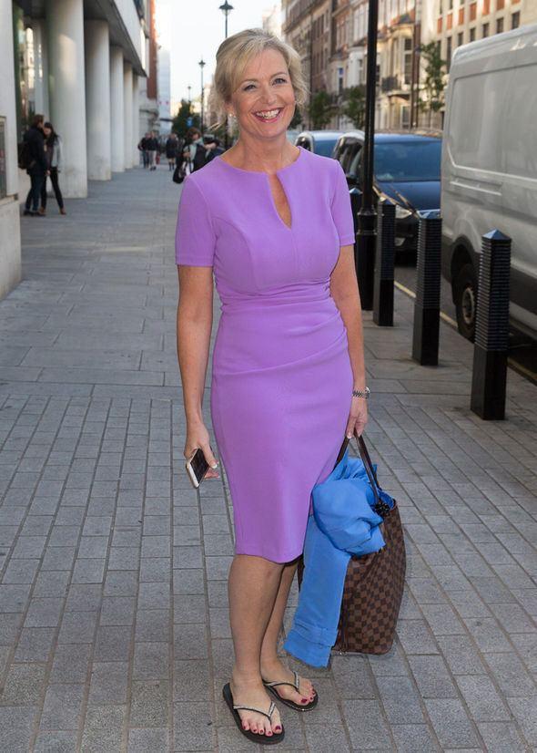Carol Kirkwood Carol Kirkwood looks luscious in lilac as she admits she