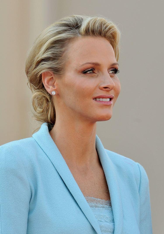 Charlene, Princess of Monaco Princess Charlene of Monaco smiles in her baby blue Chanel