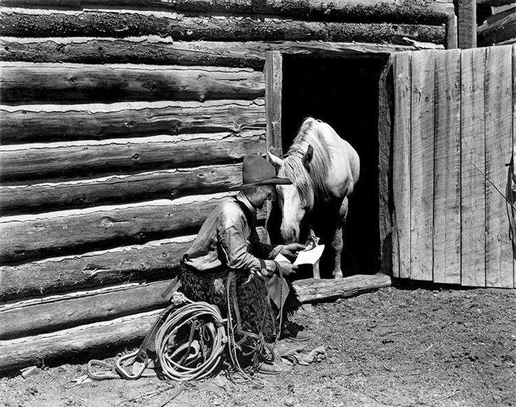 Charles Belden Treasures Charles Belden photograph cowboy reading to horse