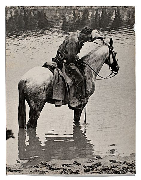 Charles Belden Charles J Belden Photograph of A Mounted Cowboy with Pack