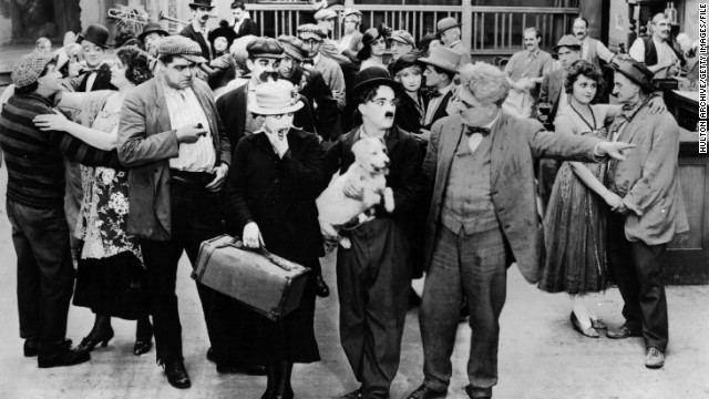 Charlie Chaplin (film) movie scenes From humble beginnings growing up in an impoverished home and orphanages in London Chaplin became one of the most famous film stars