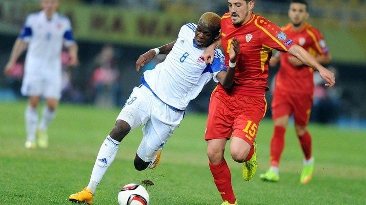 Christopher Martins Pereira Macedonia39s midfielder Arijan Ademi R vies with