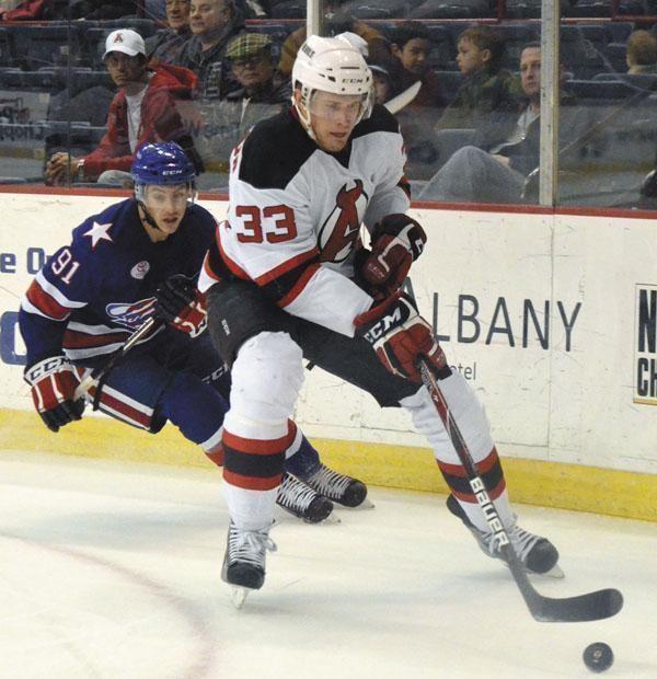 Corbin McPherson Albany Devils Corbin McPherson 33 keeps the puck away from