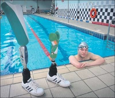 Darragh McDonald Swimmer Darragh really shows off the green white and gold