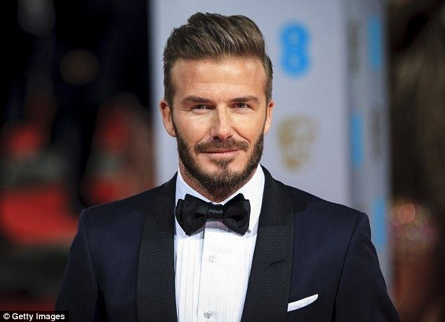 David Beckham David Beckham dazzles on the red carpet as he presents an