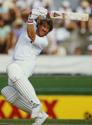 Ian Botham plunders 24 runs in an over off Derek Stirling at The
