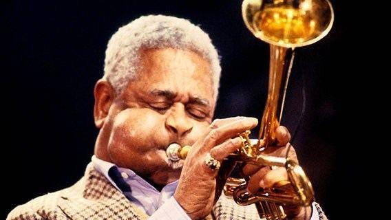 Dizzy Gillespie John Birks Dizzy Gillespie was an American jazz trumpeter