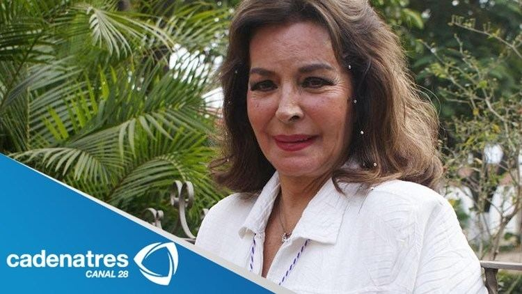 Elsa Aguirre smiling and wearing white blouse
