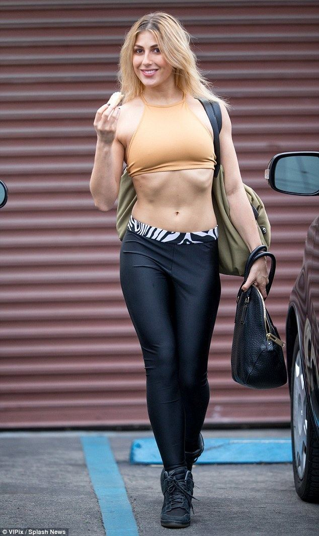 Emma Slater Emma Slater shows off her rock hard abs in tiny crop top