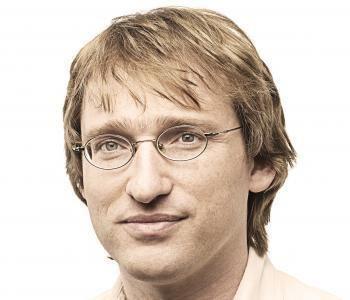 Erik Winfree smiling while wearing eyeglasses