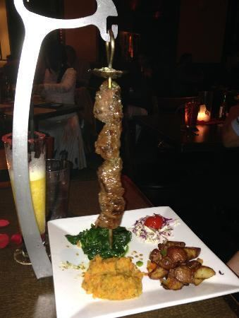Espetada Espetadaquot marinated beef on hanging skewer Served with potatoes