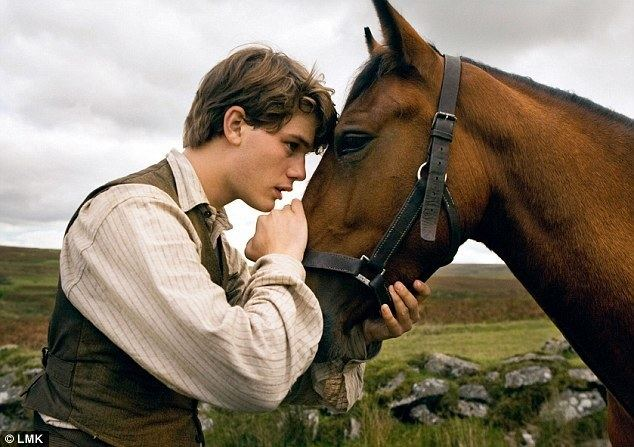 Farm Relief movie scenes Hero Jeremy Irvine as Albert and his horse Joey in a scene from the Walt