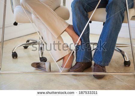 Playing footsies flirting