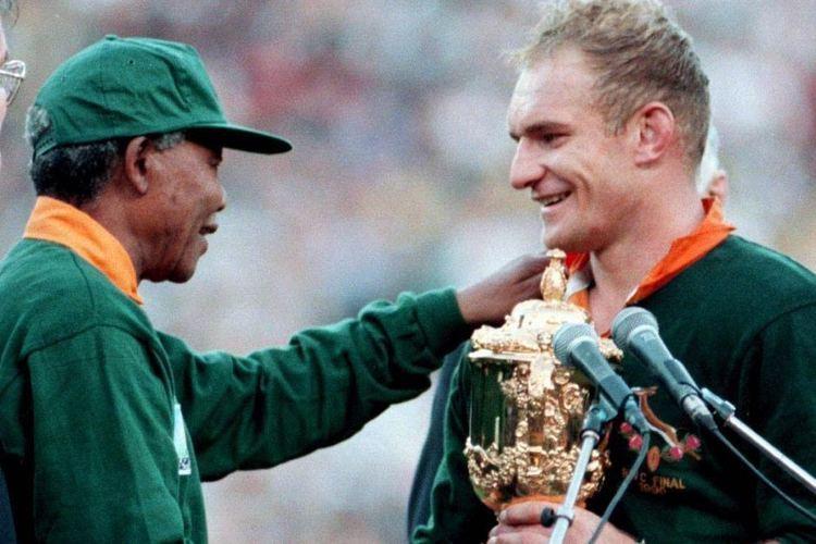 Francois Pienaar Nelson Mandela shakes hands with Springok captain Francois