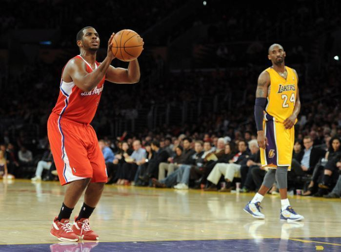 Free throw Chris Paul shoots a free throw as Kobe Bryant watches Clippers