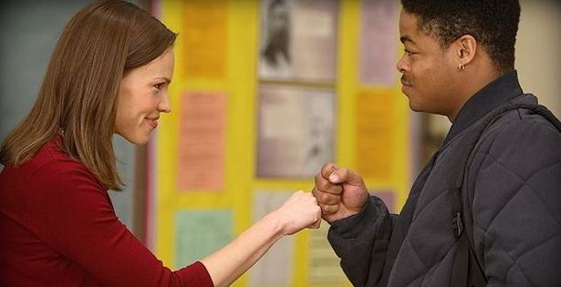 Freedom at the Edge movie scenes Hillary Swank portraying Erin Gruwell fist bumps with a student in Freedom Writers Paramount Pictures