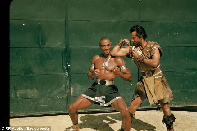 Gaby (film) movie scenes This never before seen still shows Yul Brynner left play fighting on