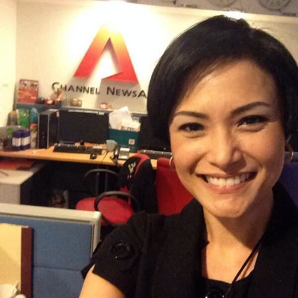 Glenda Chong smiling and wearing black blouse at Channel NewsAsia