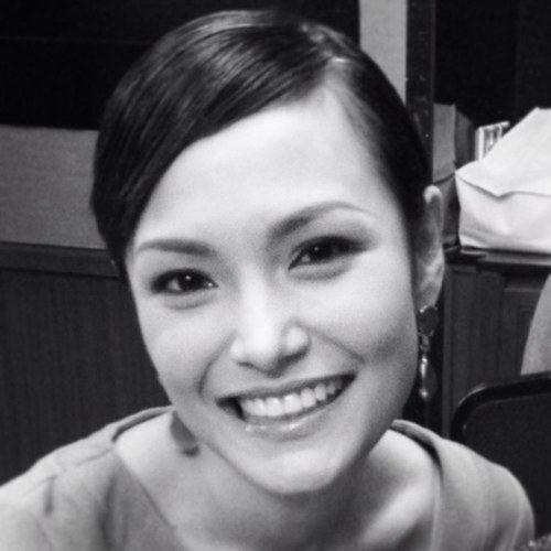 Glenda Chong smiling and wearing earrings