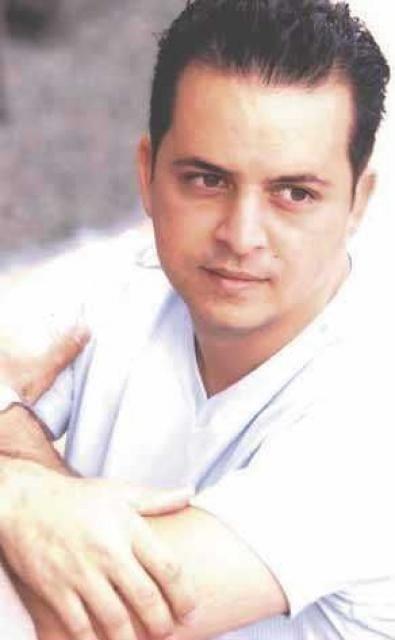 Glenn Medeiros wearing a white shirt
