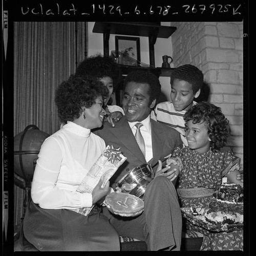 Greg Morris Calisphere Actor Greg Morris surrounded by his family holding his